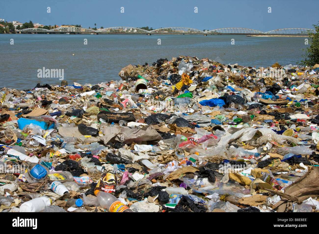 Pollution Waste and the Faidherbe Bridge in St Louis in Senegal Africa - Stock Image