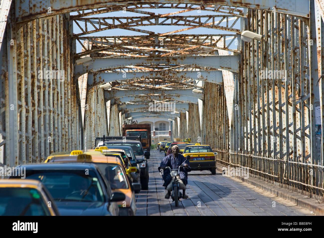 Traffic on the Faidherbe Bridge in St Louis in Senegal Africa - Stock Image