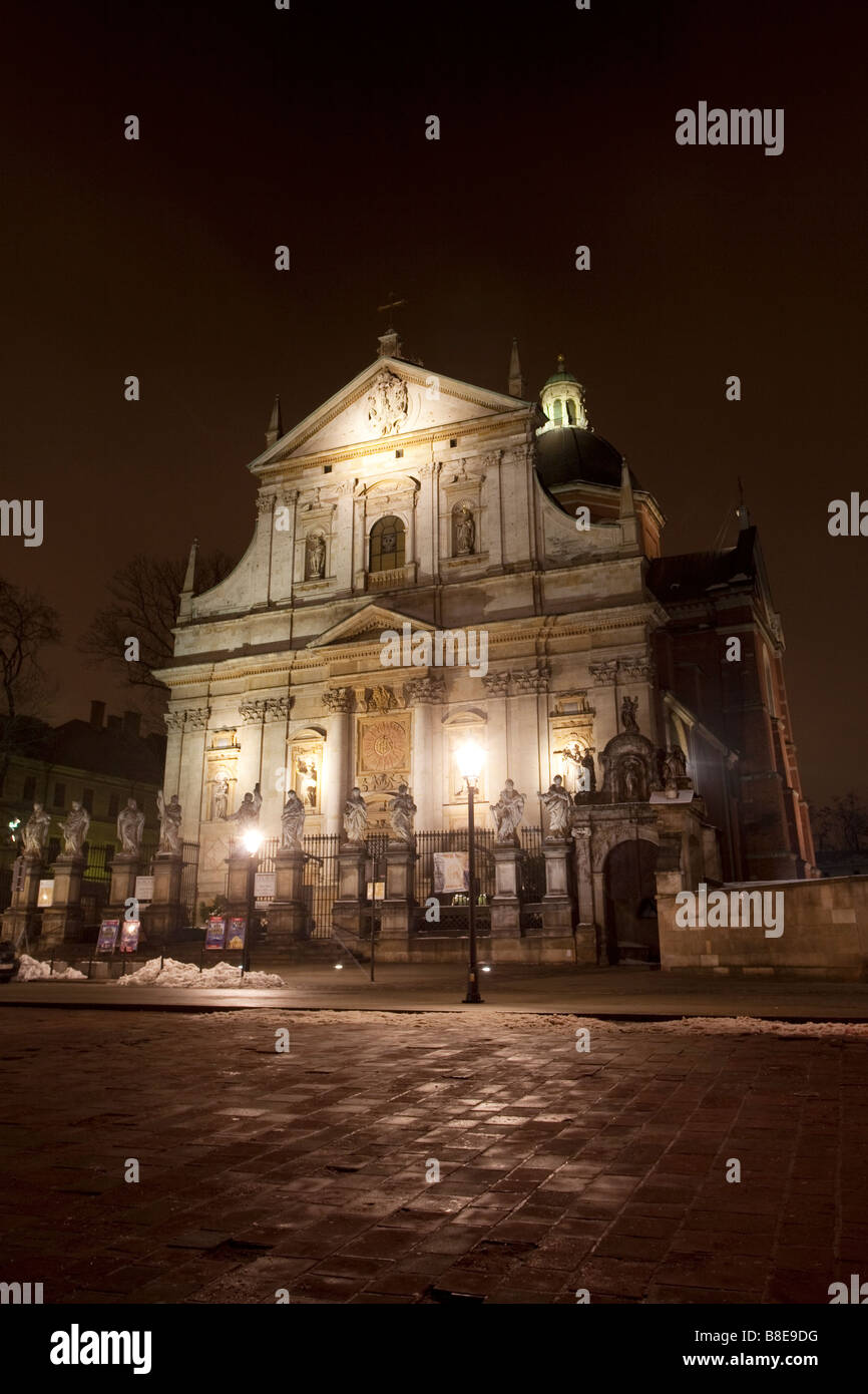 Church of Saints Peter and Paul at night. St Mary Magdelene Square, Kanoniczna Street, Krakow, Poland Stock Photo