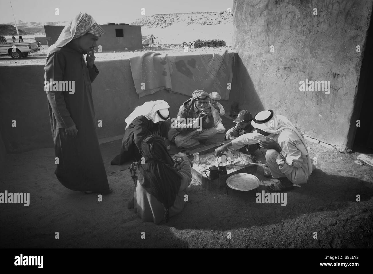 A group of Bedouins eat a meal outside their home in Egypt - Stock Image