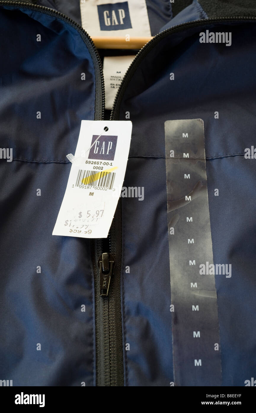 Gap item showing multiple markdowns on it's price tag which illustrates difficult economic times and a slowdown Stock Photo