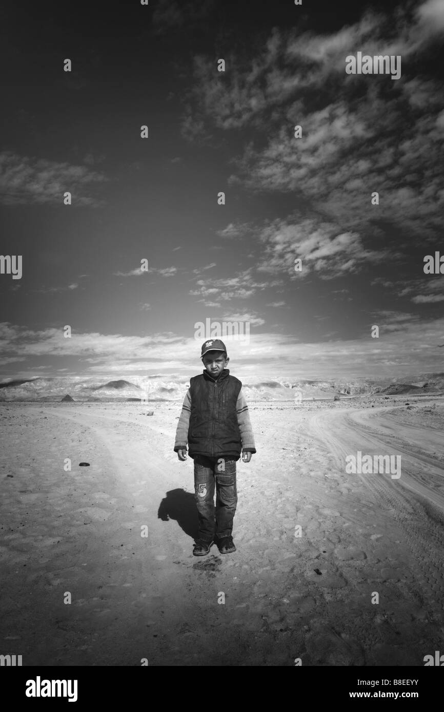 Black and white of a bedouin boy in a landscape in Egypt - Stock Image