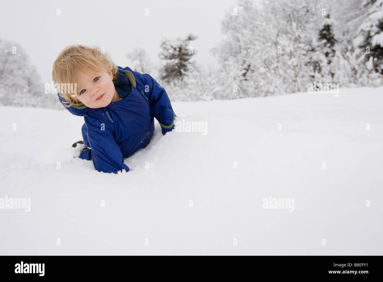 Young boy on a winter walk in Pedro Bay, Alaska - Stock Image