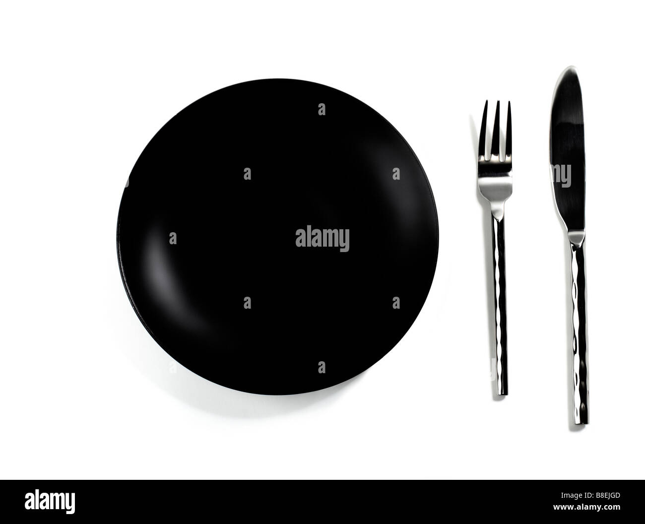 Empty Black Dinner Plate and Silverware - Stock Image