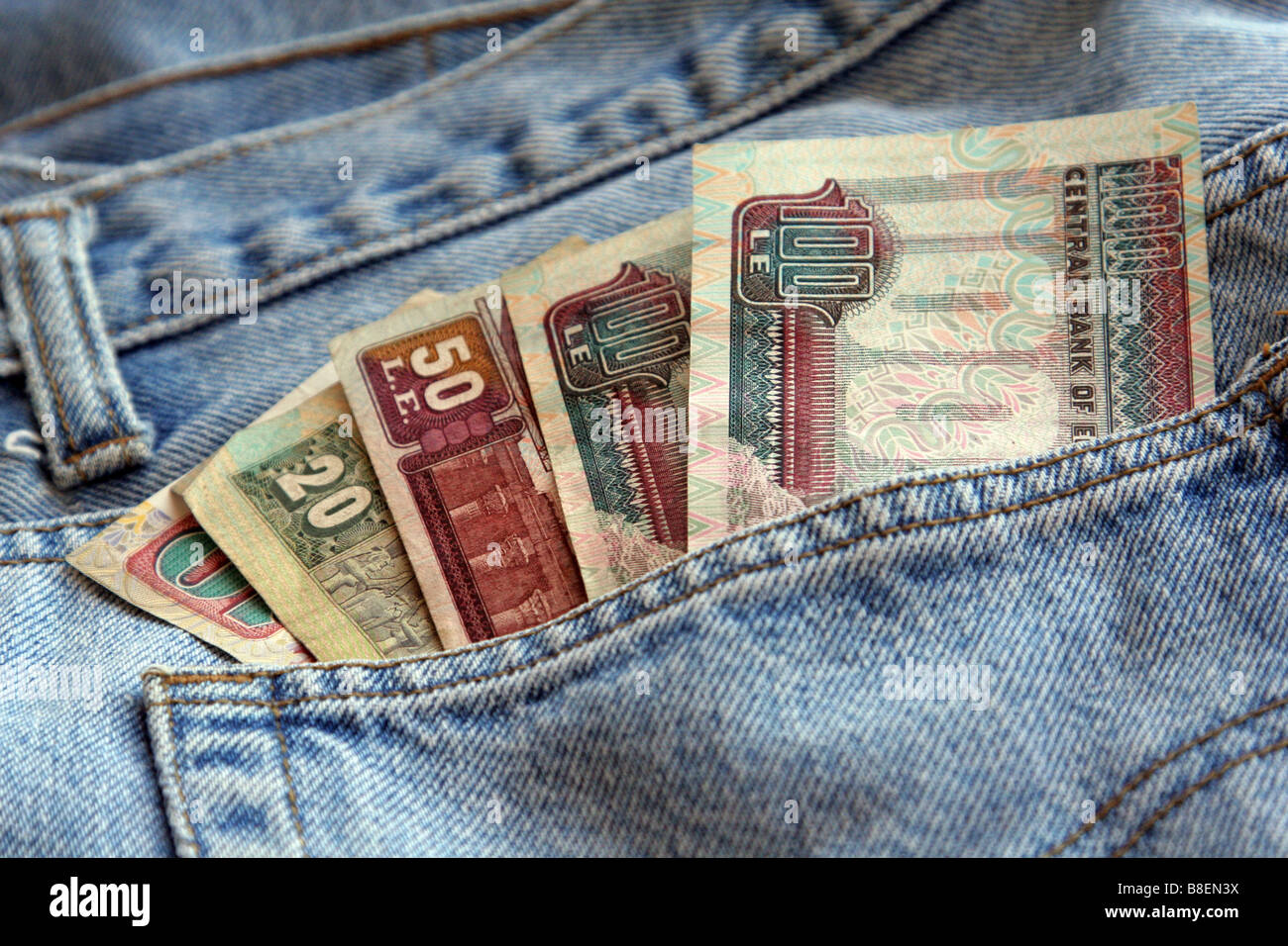 Egyptian Currencies in jeans pocket - Stock Image