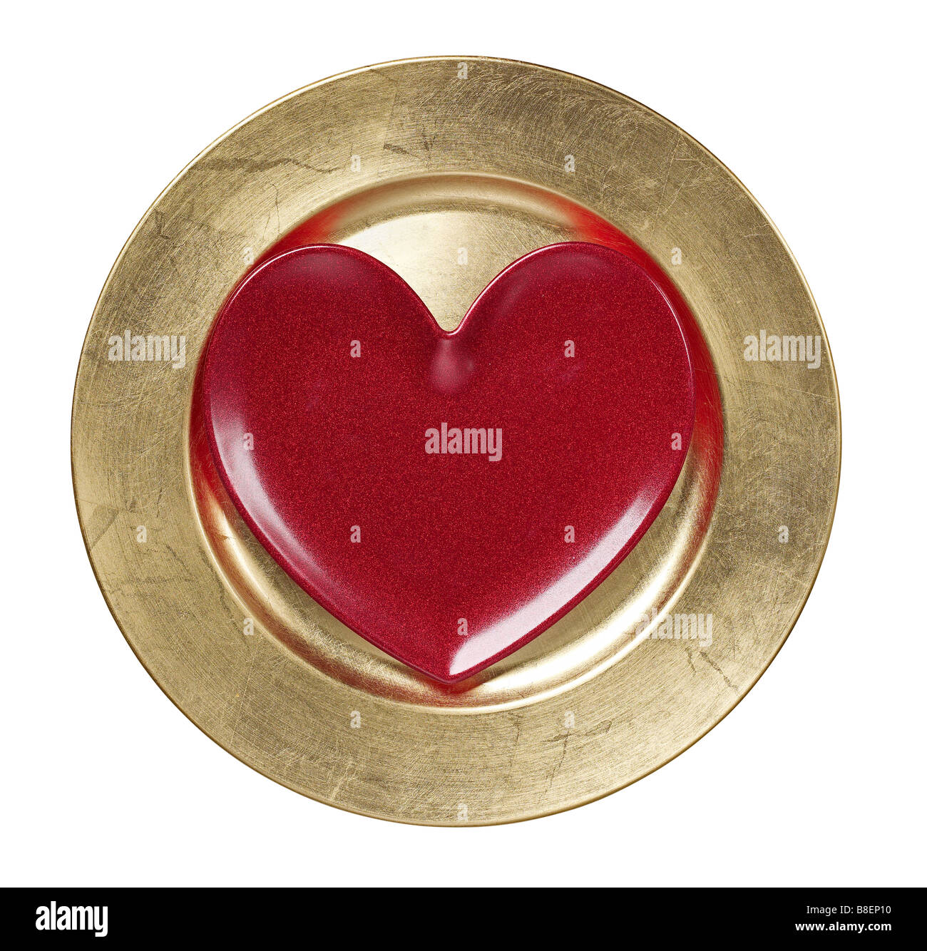 Heart on gold charger plate - Stock Image