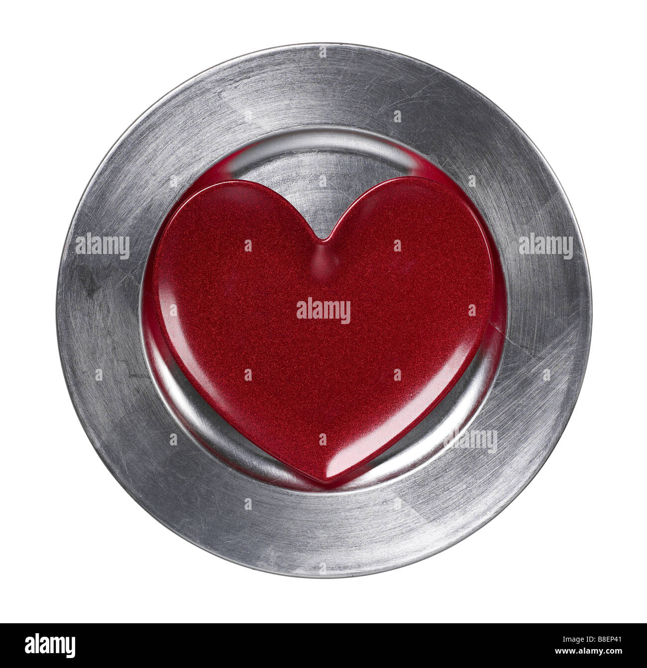 Heart on silver charger plate - Stock Image