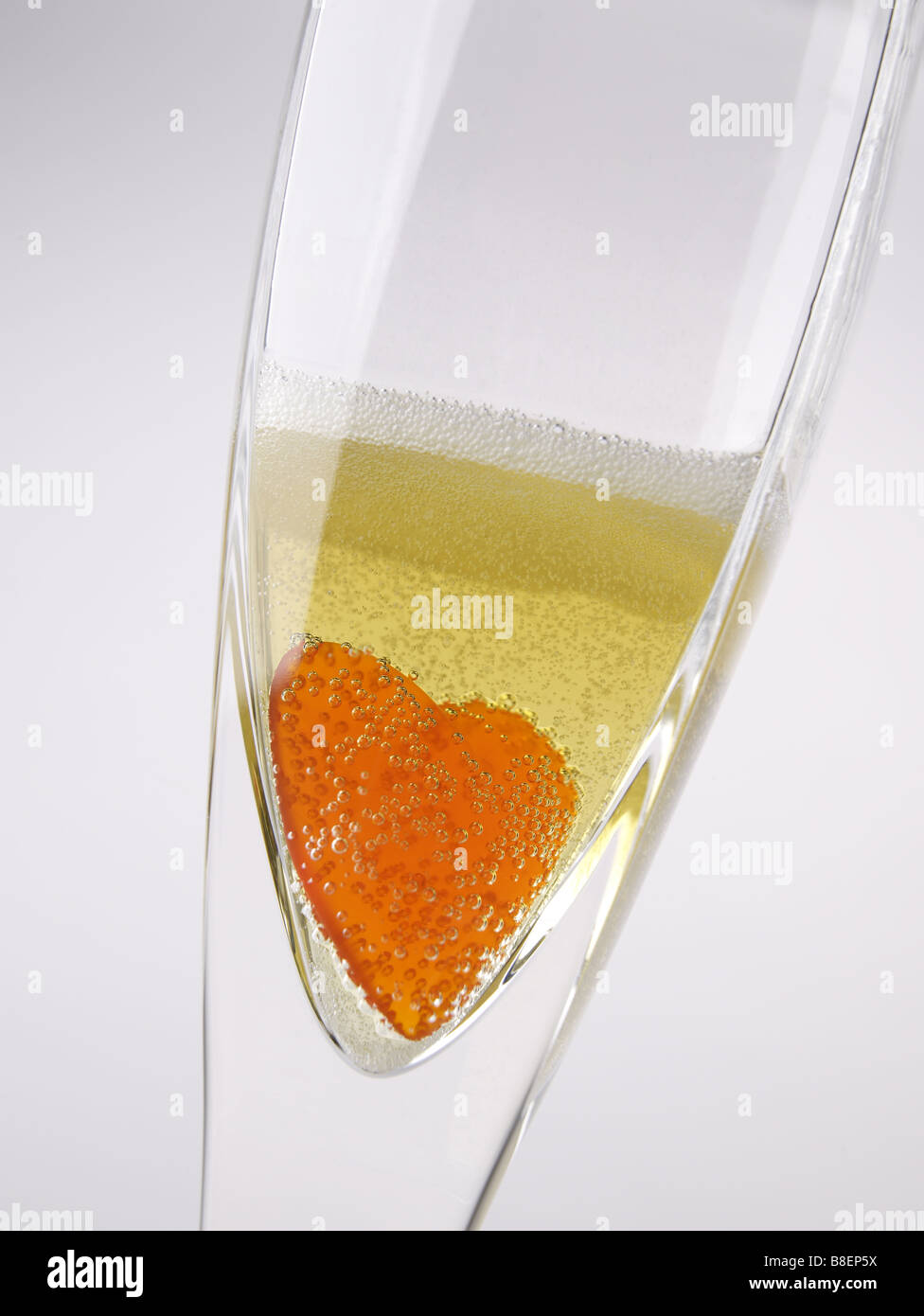 heart in champagne bubbles glass - Stock Image
