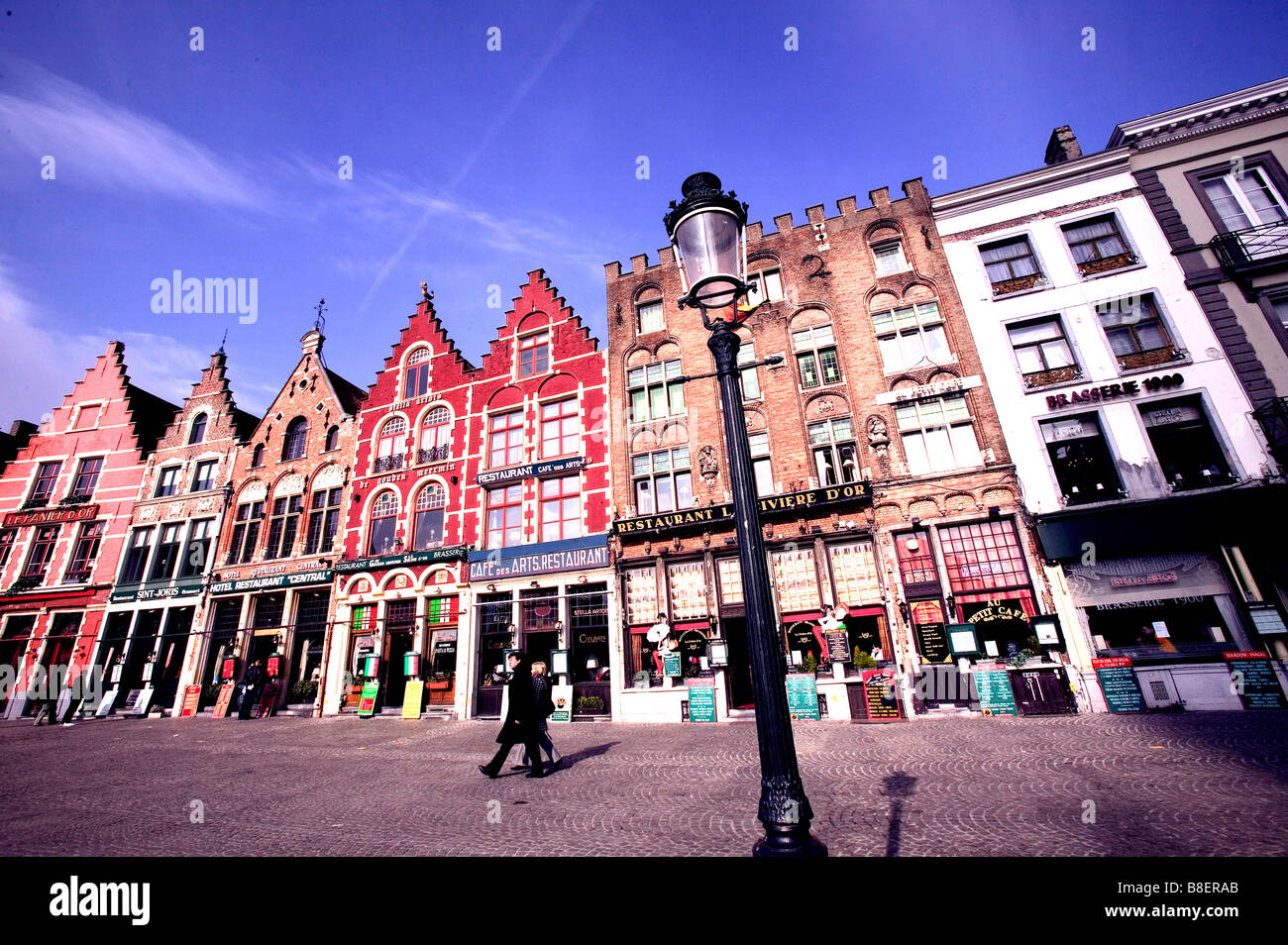 A row of cafes in the main square of Bruges Belgium - Stock Image