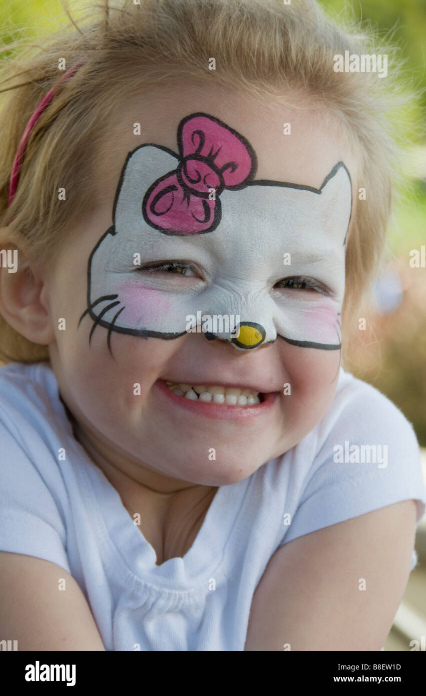 'Hello Kitty' Girl Age 3 with Facepaint - Stock Image
