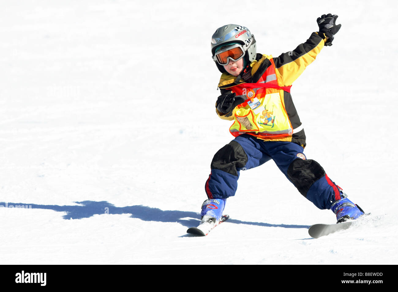 A kid learning skiing - Stock Image