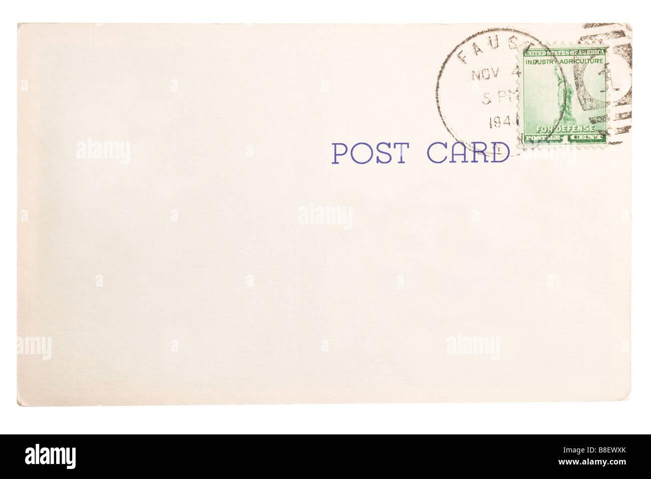 Vintage yellowed postcard with postmark stamp - Stock Image