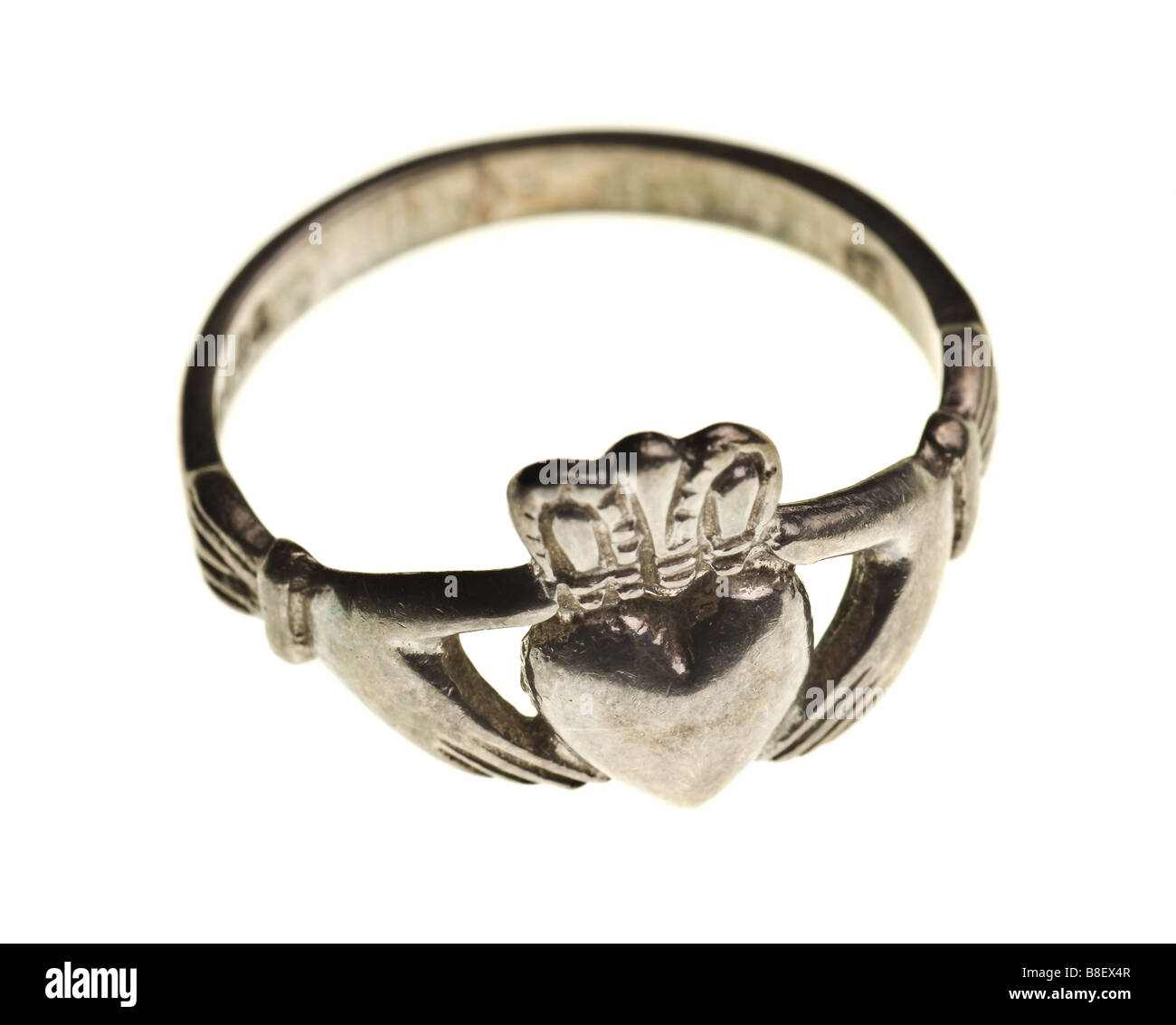 vintage traditional Claddagh ring isolated on a pure white background - Stock Image