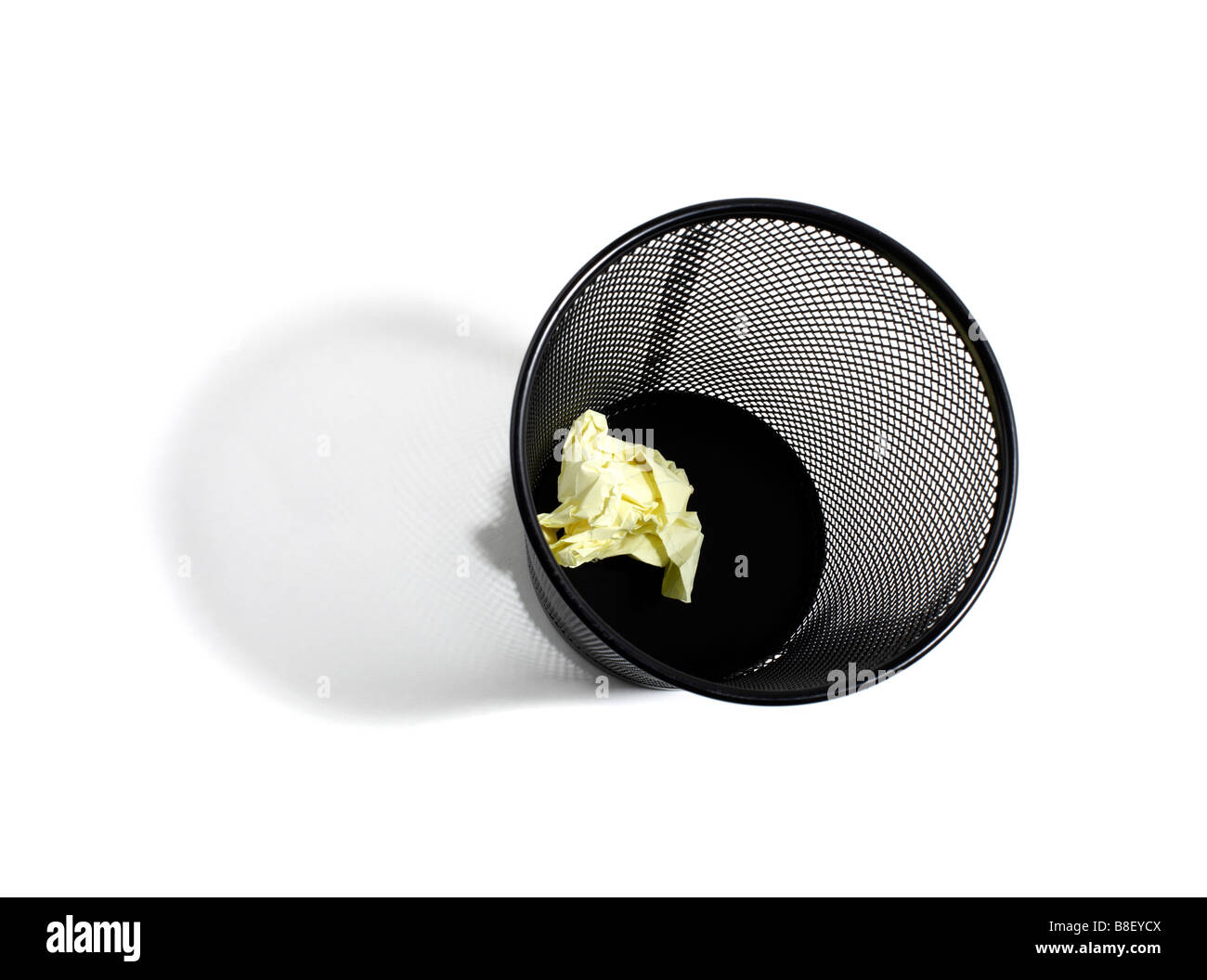 Wastebasket with one wad of paper - Stock Image