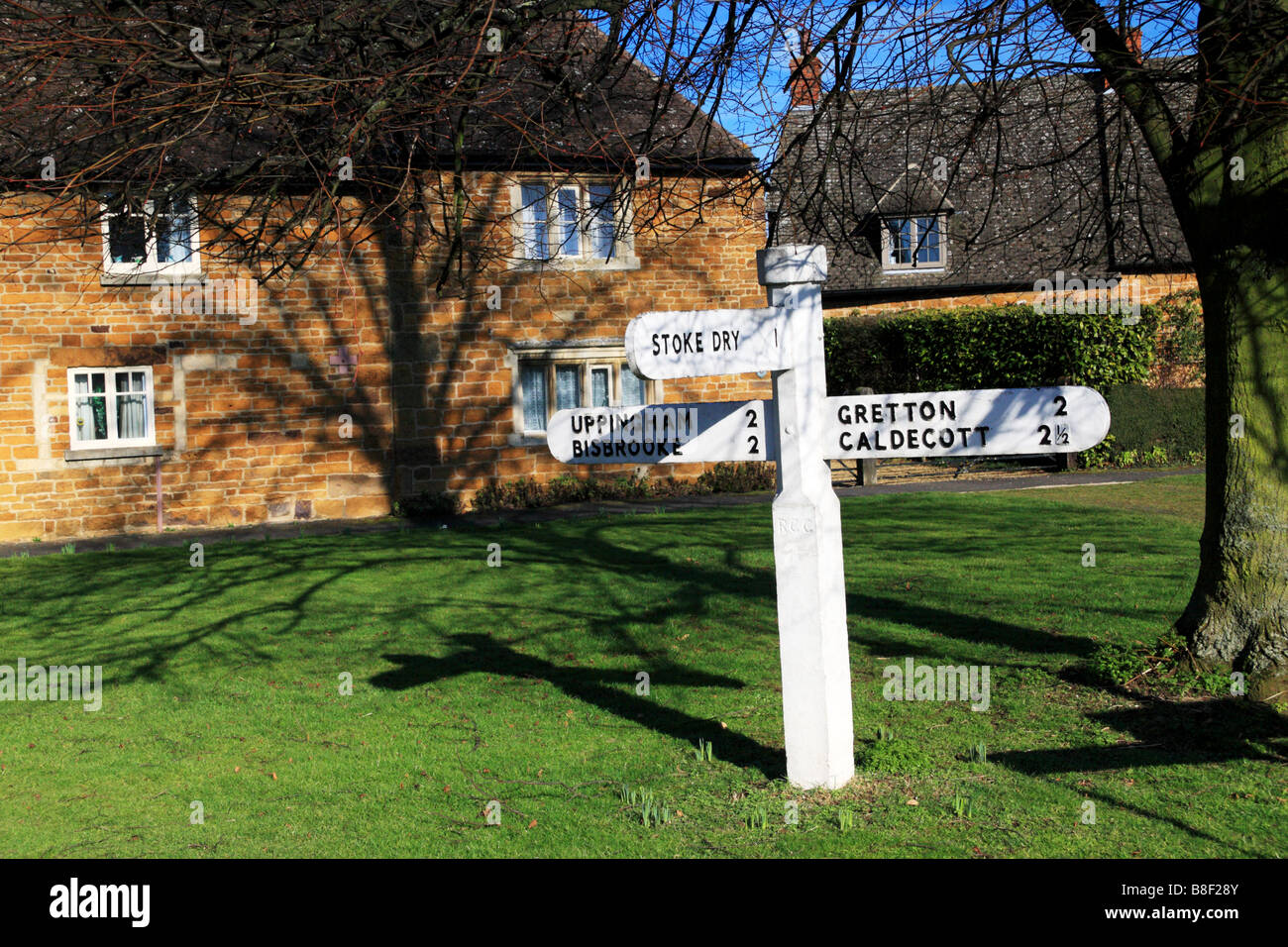 A village finger post with direction signs - Stock Image