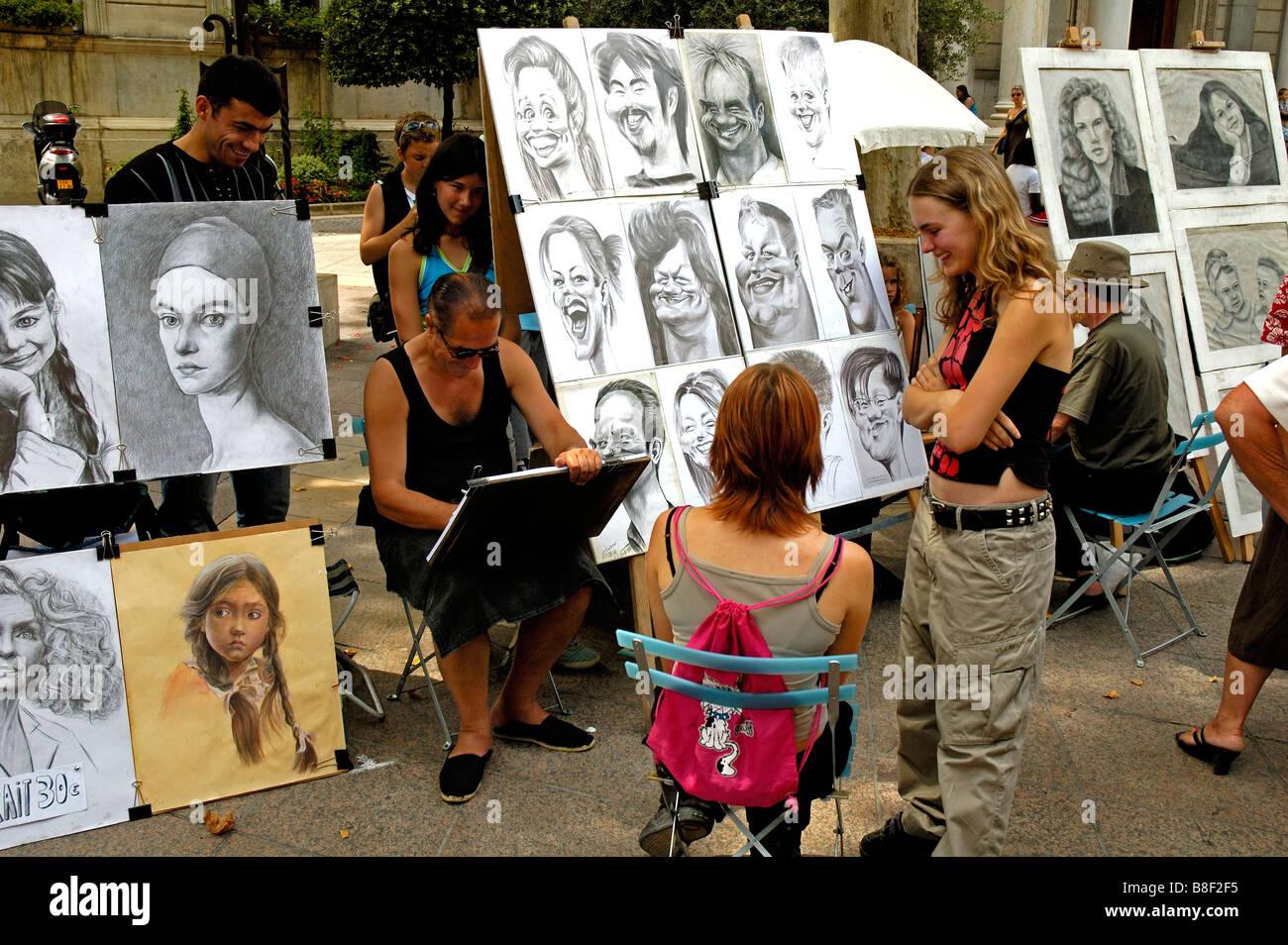 Street artist at work , Avignon, Provence, France. - Stock Image