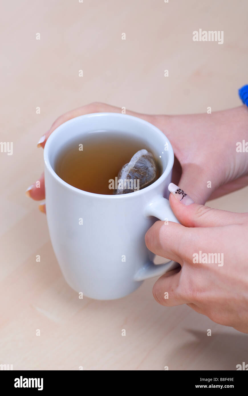 Close up of a woman drinking tea - Stock Image