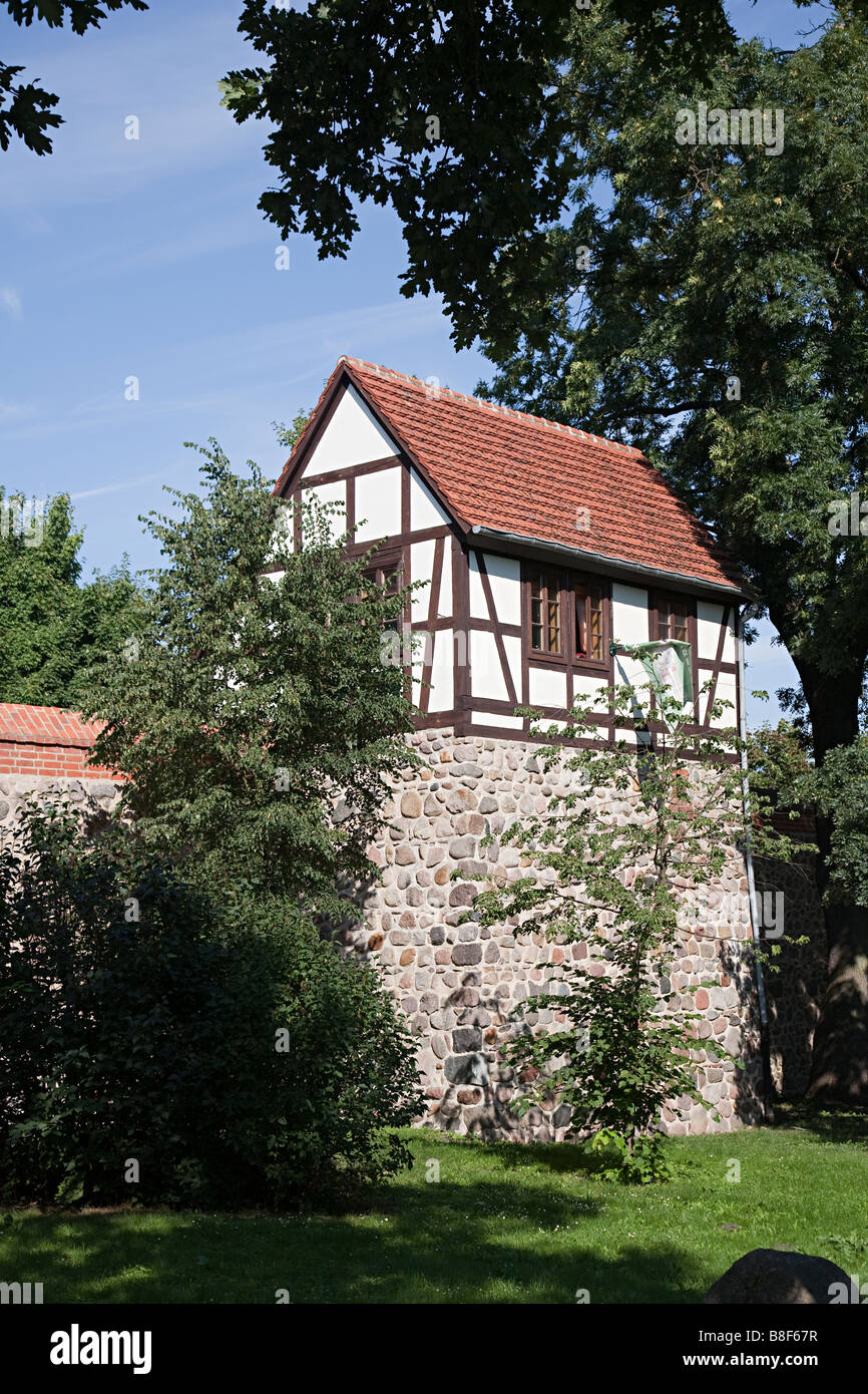 Wiek House defensive tower built into the city wall and now converted to private dwelling Neubrandenburg Germany - Stock Image
