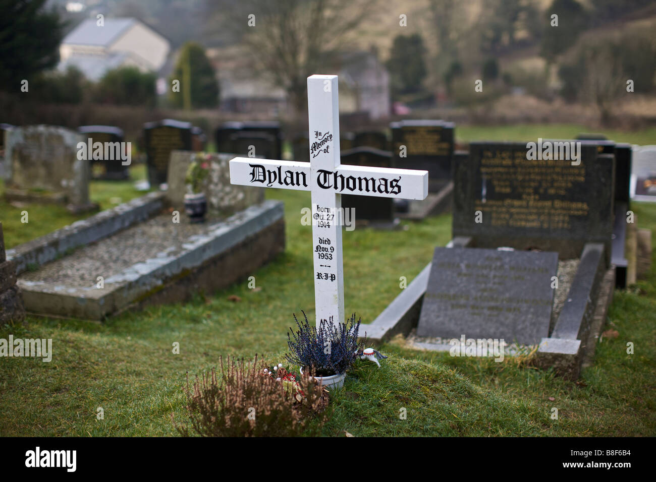 Dylan Thomas grave at St Martins Church in Laugharne Dyfed Wales - Stock Image