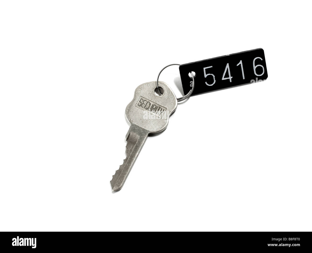 Safety deposit box key and tag - Stock Image
