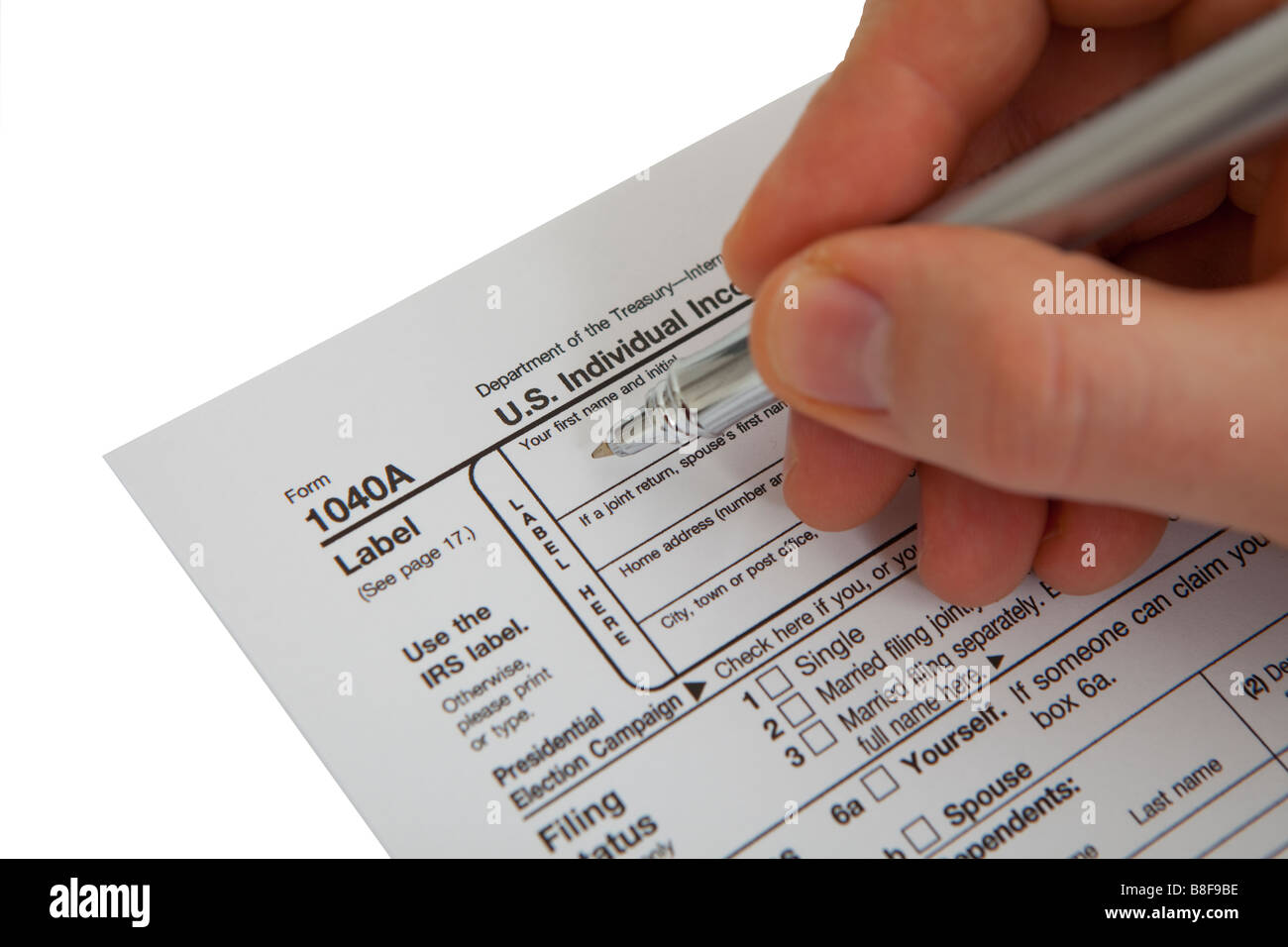 Filling income tax form with pen isolated against white background filling income tax form with pen isolated against white background solutioingenieria Choice Image