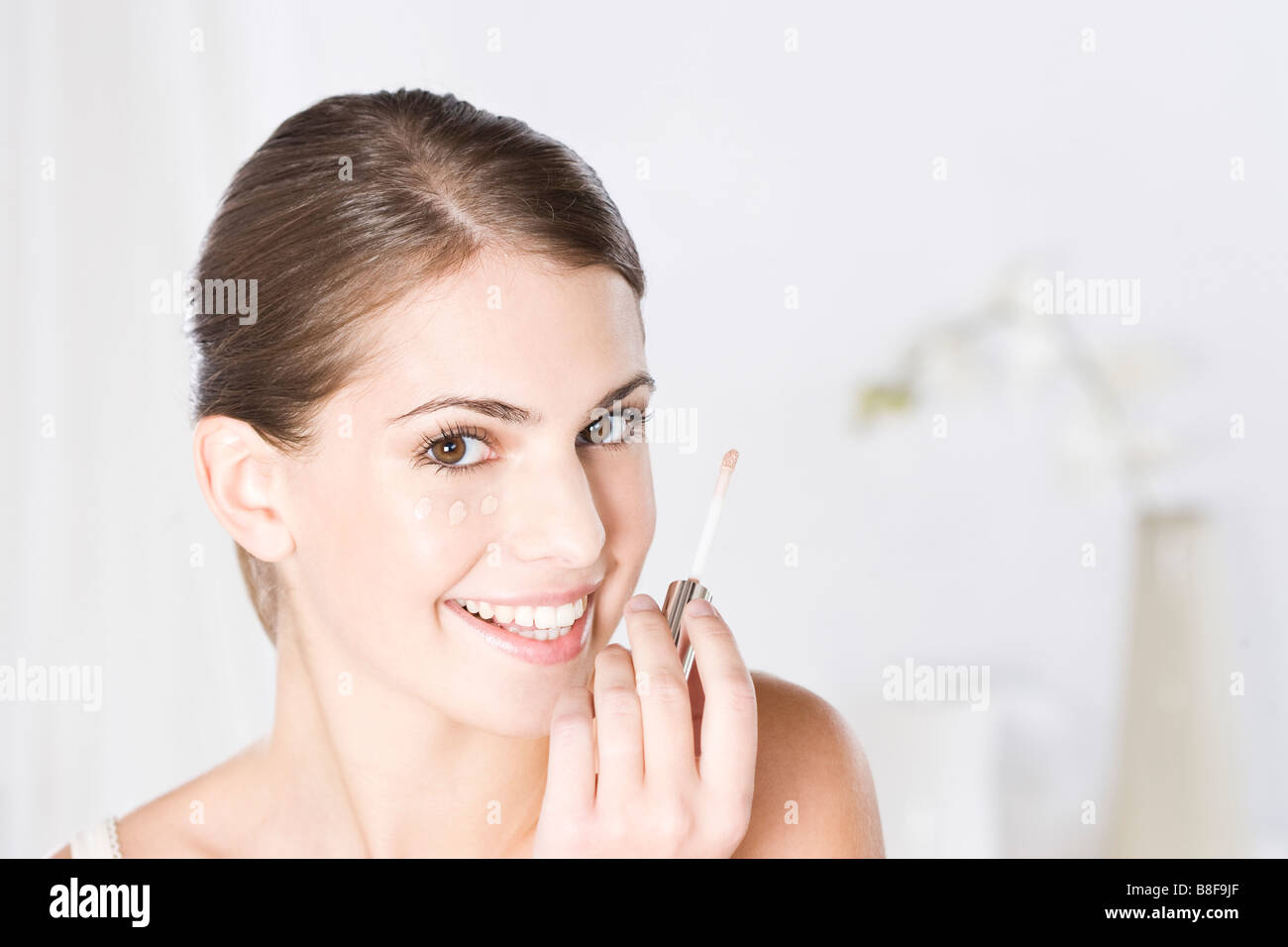woman holding make-up pad - Stock Image