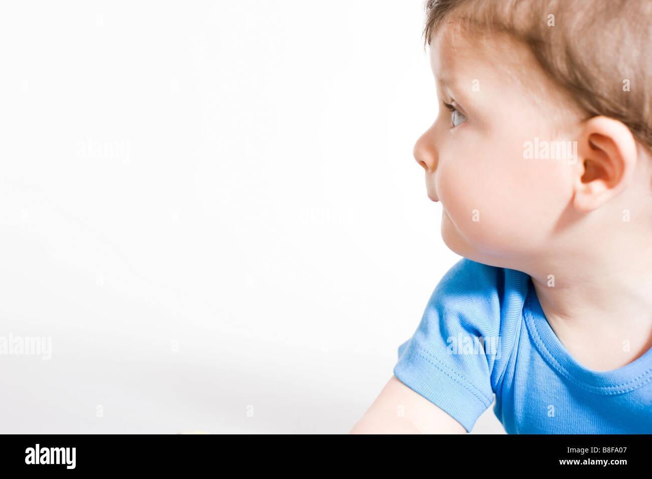 baby boy looking left - Stock Image