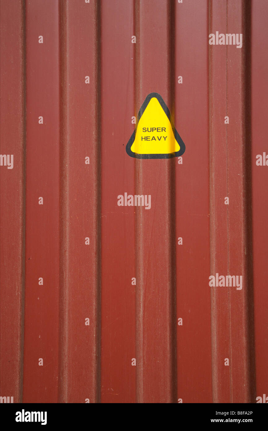 Caution sign on a shipping container - Stock Image