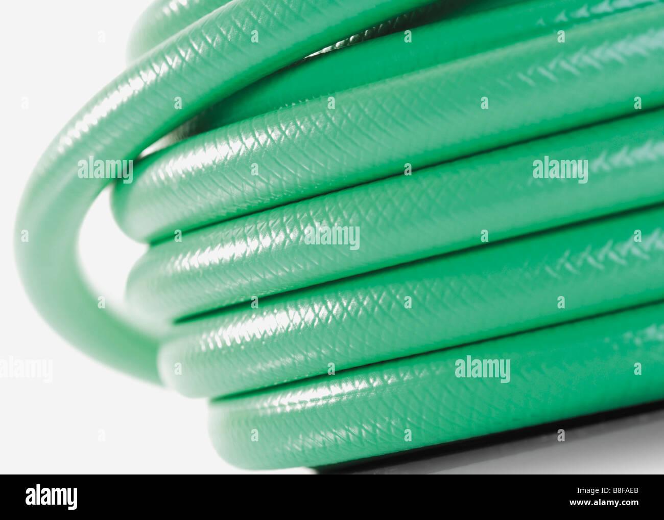 Green hosepipe - Stock Image