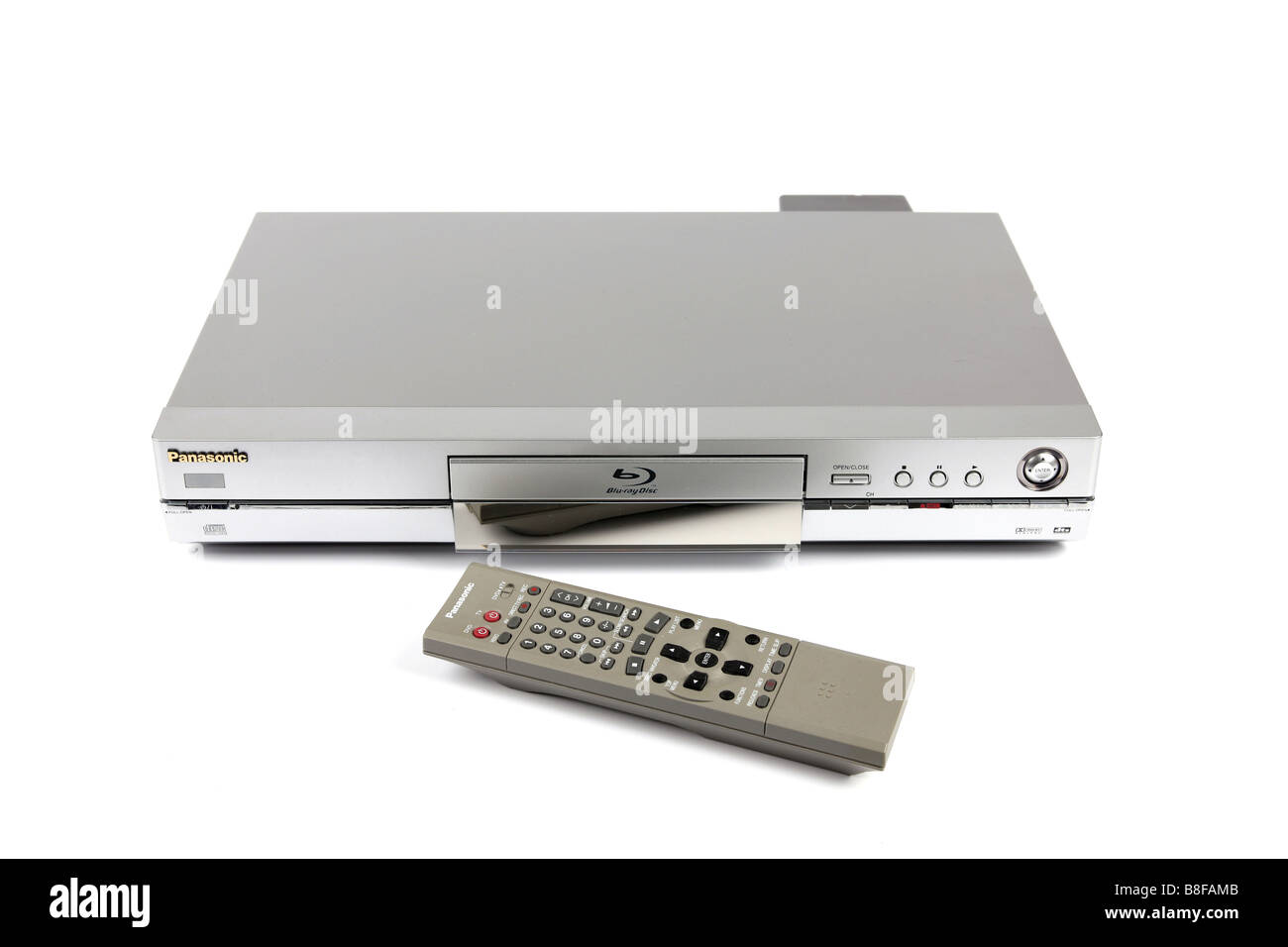 A DVD Blu Ray Digital TV Recorder and remote against a white background - Stock Image