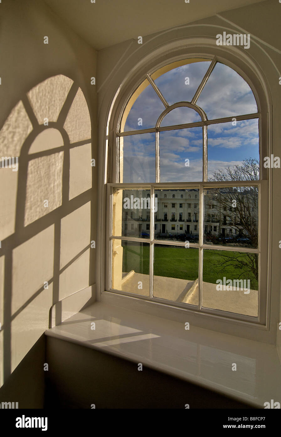 Interior. Looking out of an arched window. Regency architecture, Brunswick Square, Hove, East Sussex, England - Stock Image