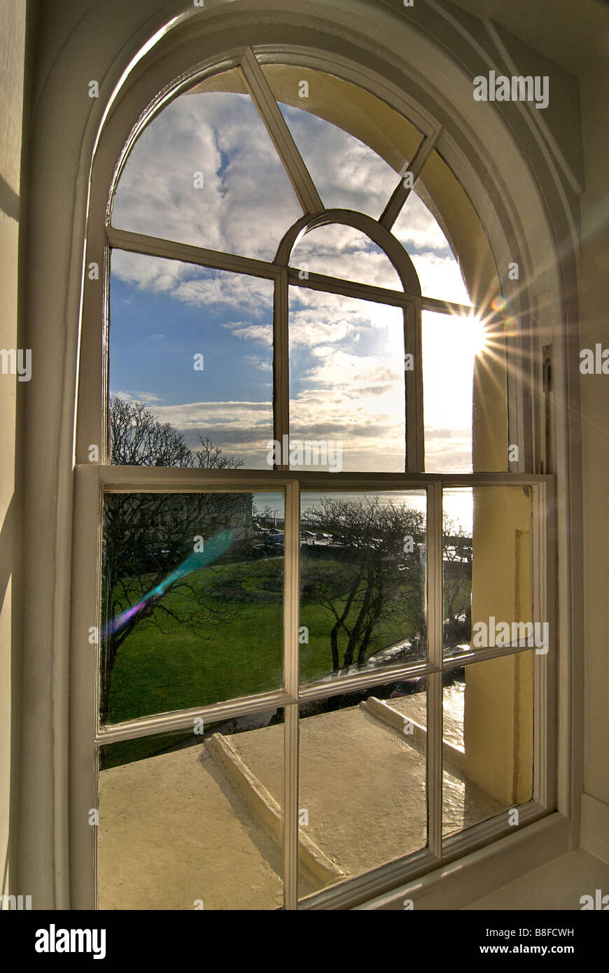 Interior. Looking out of an arched window towards the sea. Regency architecture Brunswick Square, Hove, East Sussex, - Stock Image