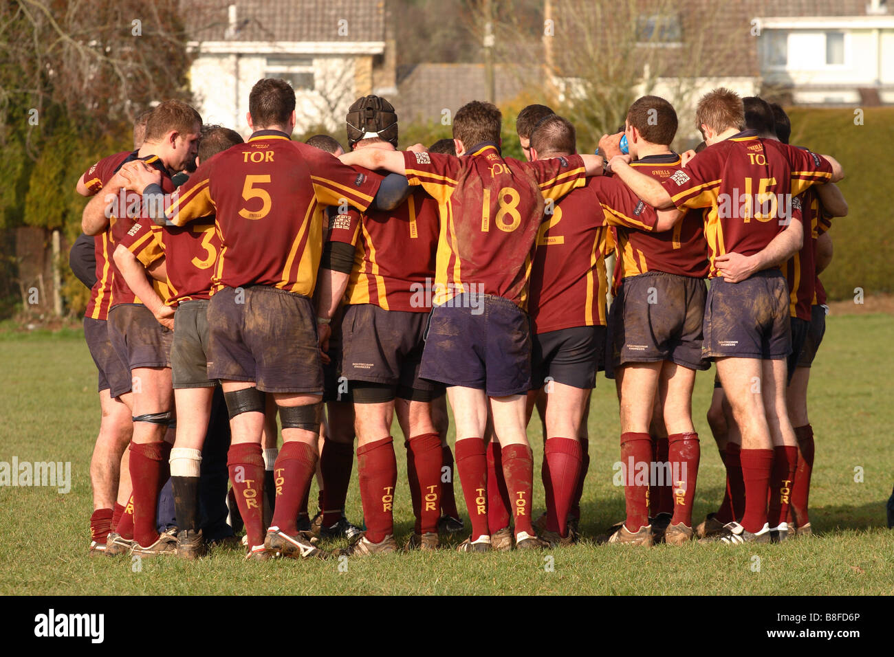 Sport rugby match half time team talk players squad members gather around their coach - Stock Image