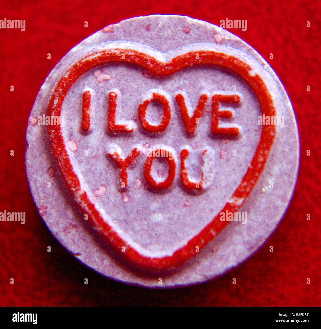 Close up of a a love heart against a red background. 'I Love You' - Stock Image