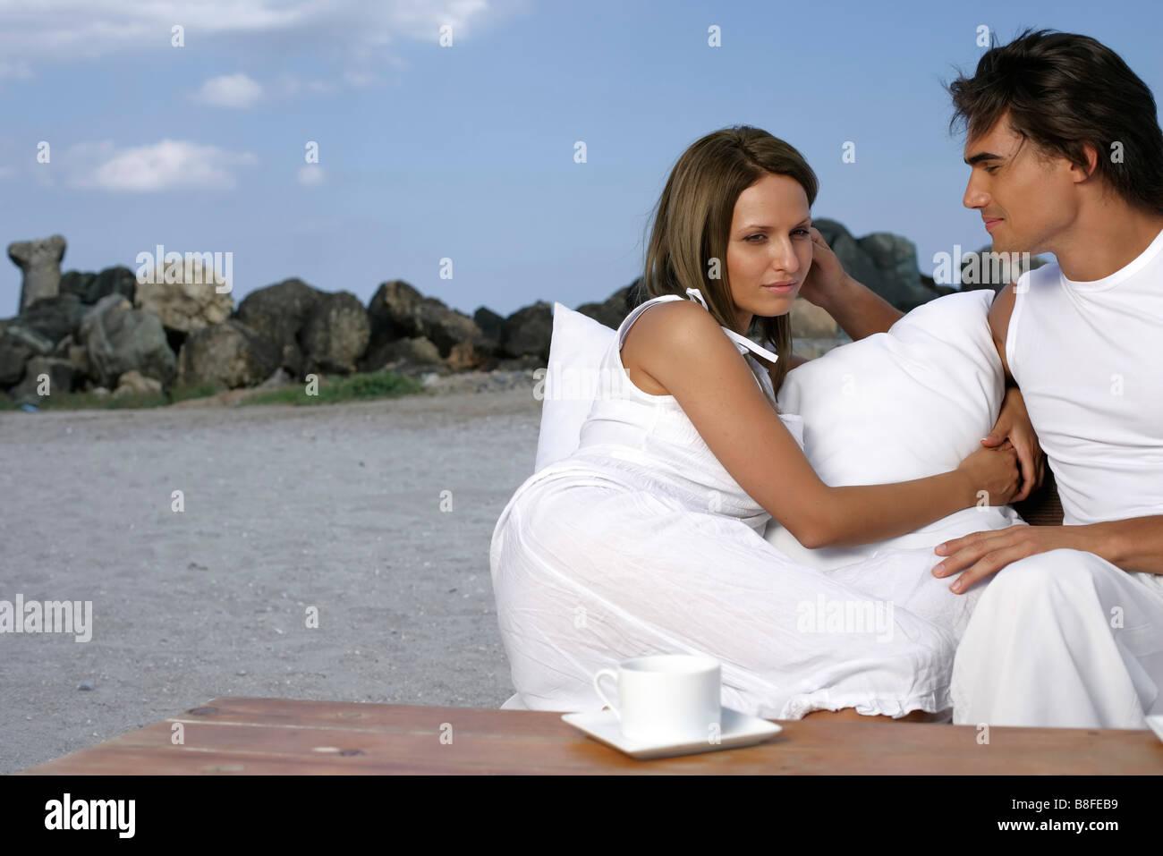Couple sitting vis-à-vis Stock Photo