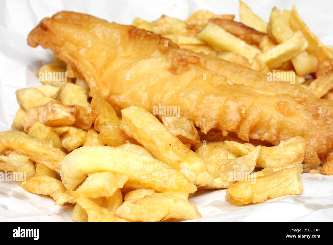 Fish and chips from a chip shop. - Stock Image