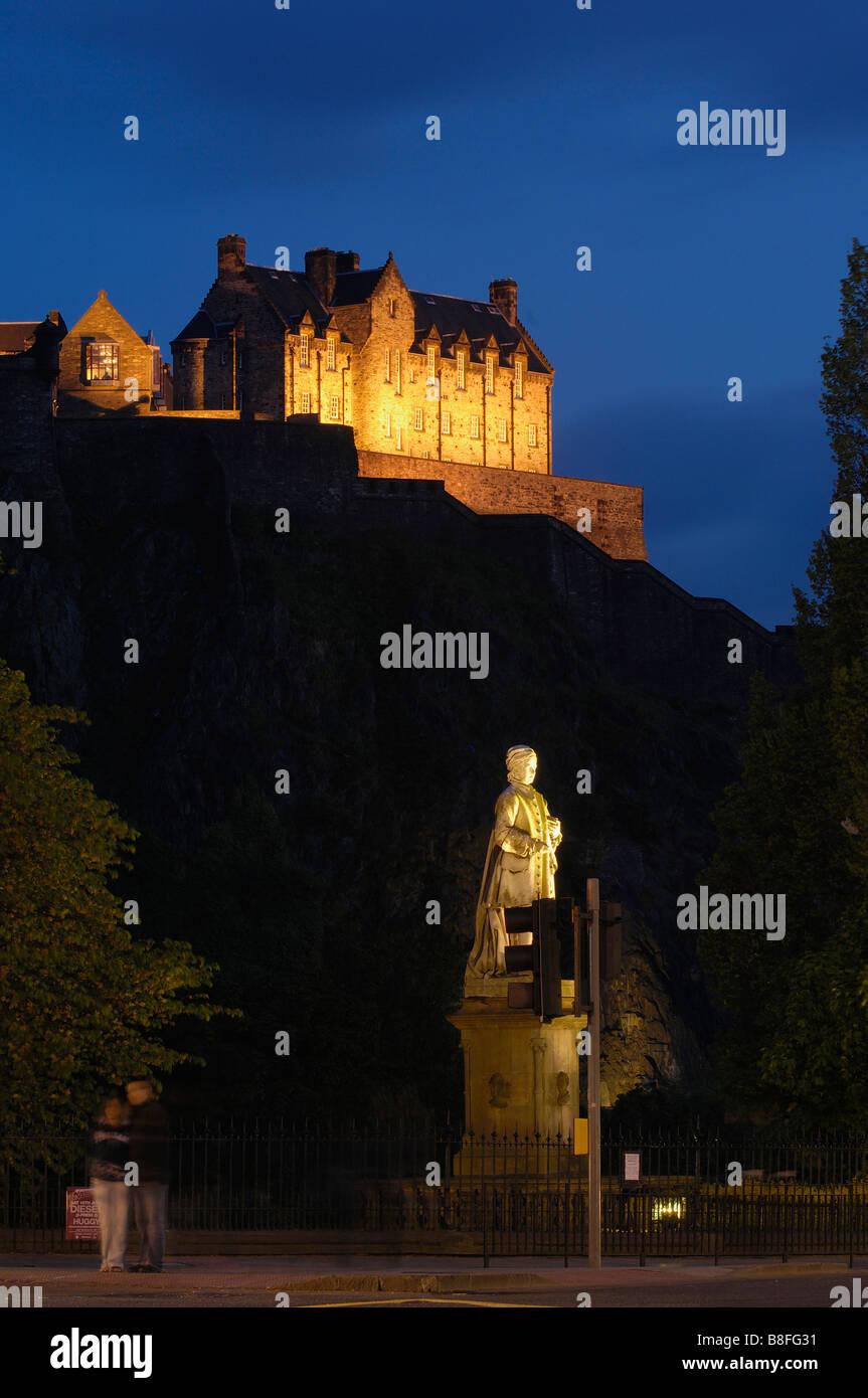 Statue of Allan Ramsay and Edinburgh Castle at background from Princes street at Dusk Edinburgh Scotland U K Stock Photo