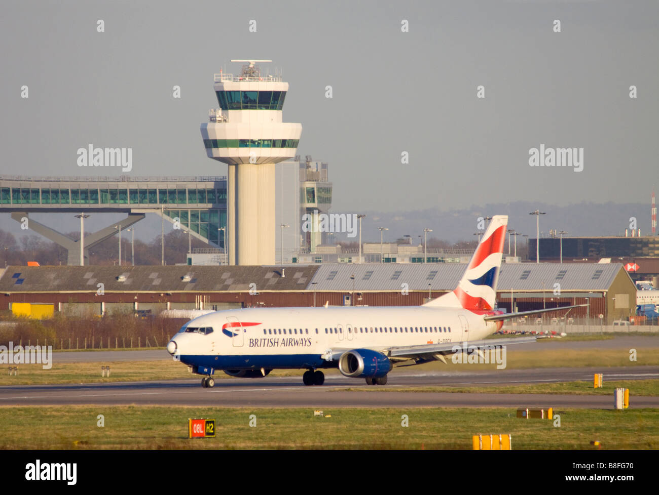 British Airways Boeing 737 436 taxing after landing at London Gatwick Airport. - Stock Image
