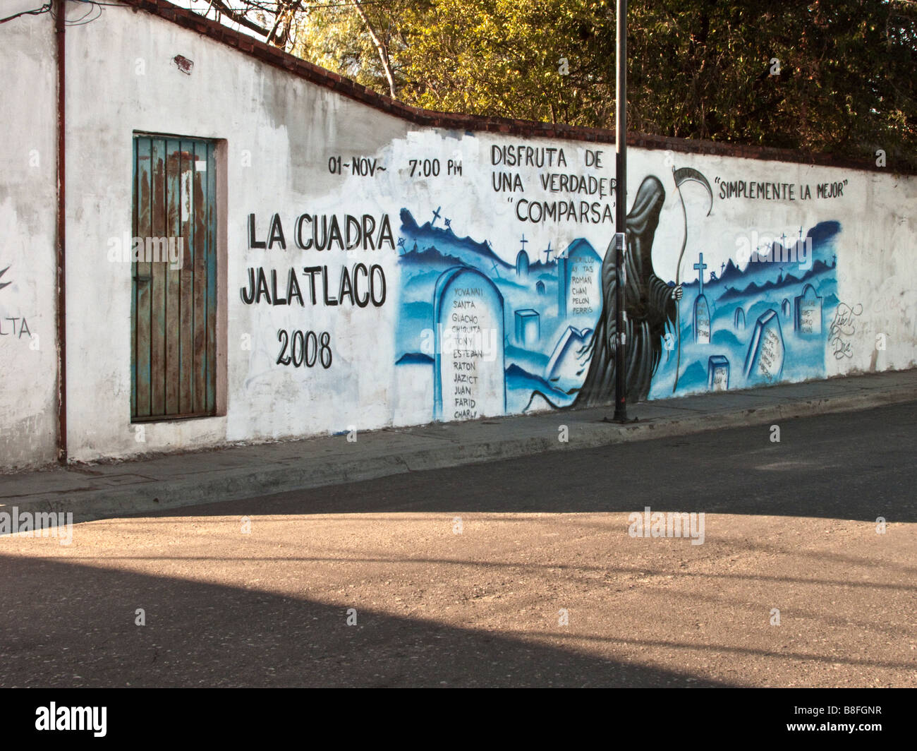 satirical wall painting in Oaxaca City memorializing the real actors (victims) in the real street pageant of the - Stock Image