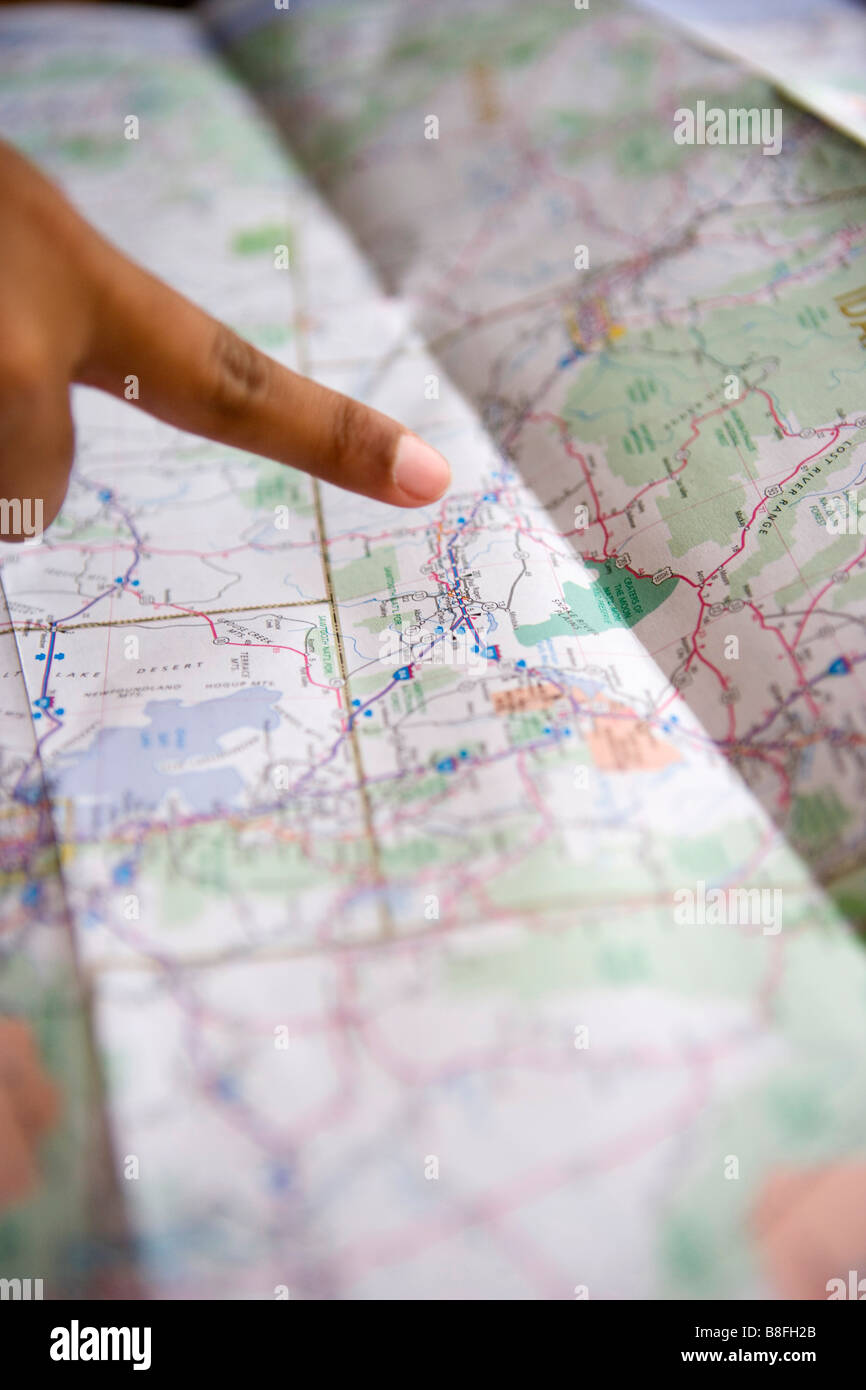 close up of a person's finger pointing at a map of southwestern united states - Stock Image