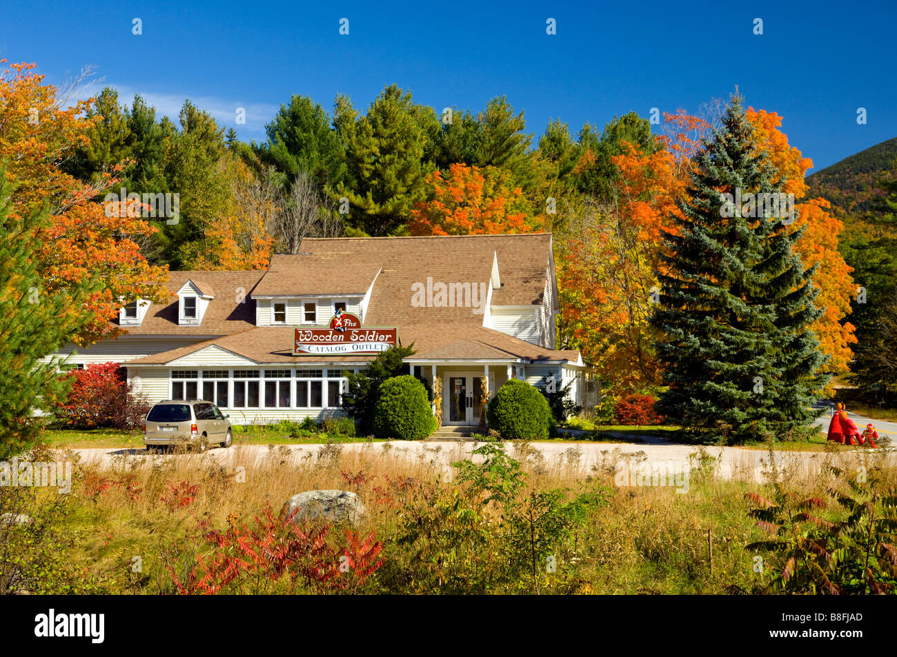 The Wooden Soldier Store With Fall Foliage Color In The Trees In