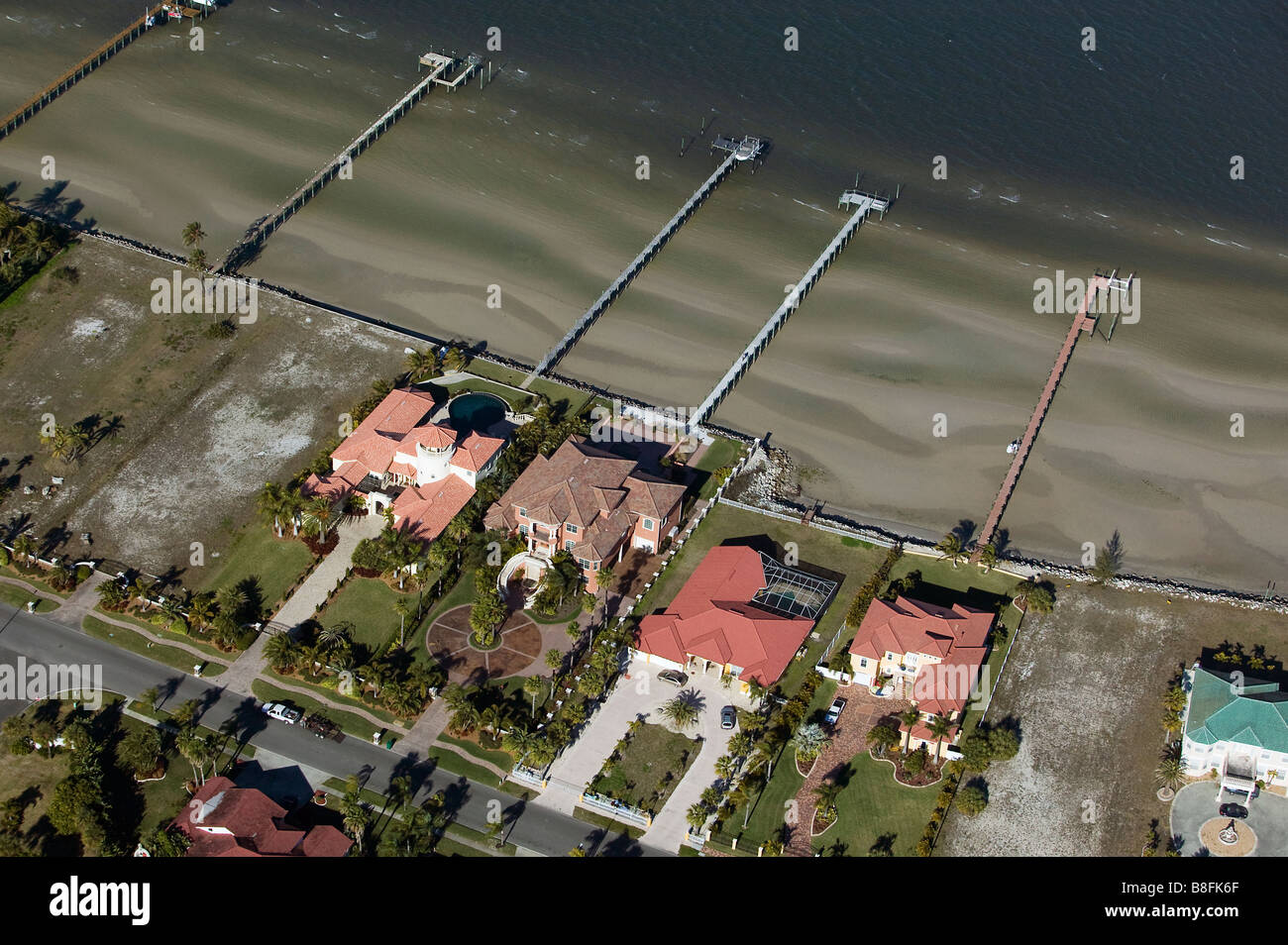 aerial view above residential piers Tampa Bay waterfront Florida low tide - Stock Image