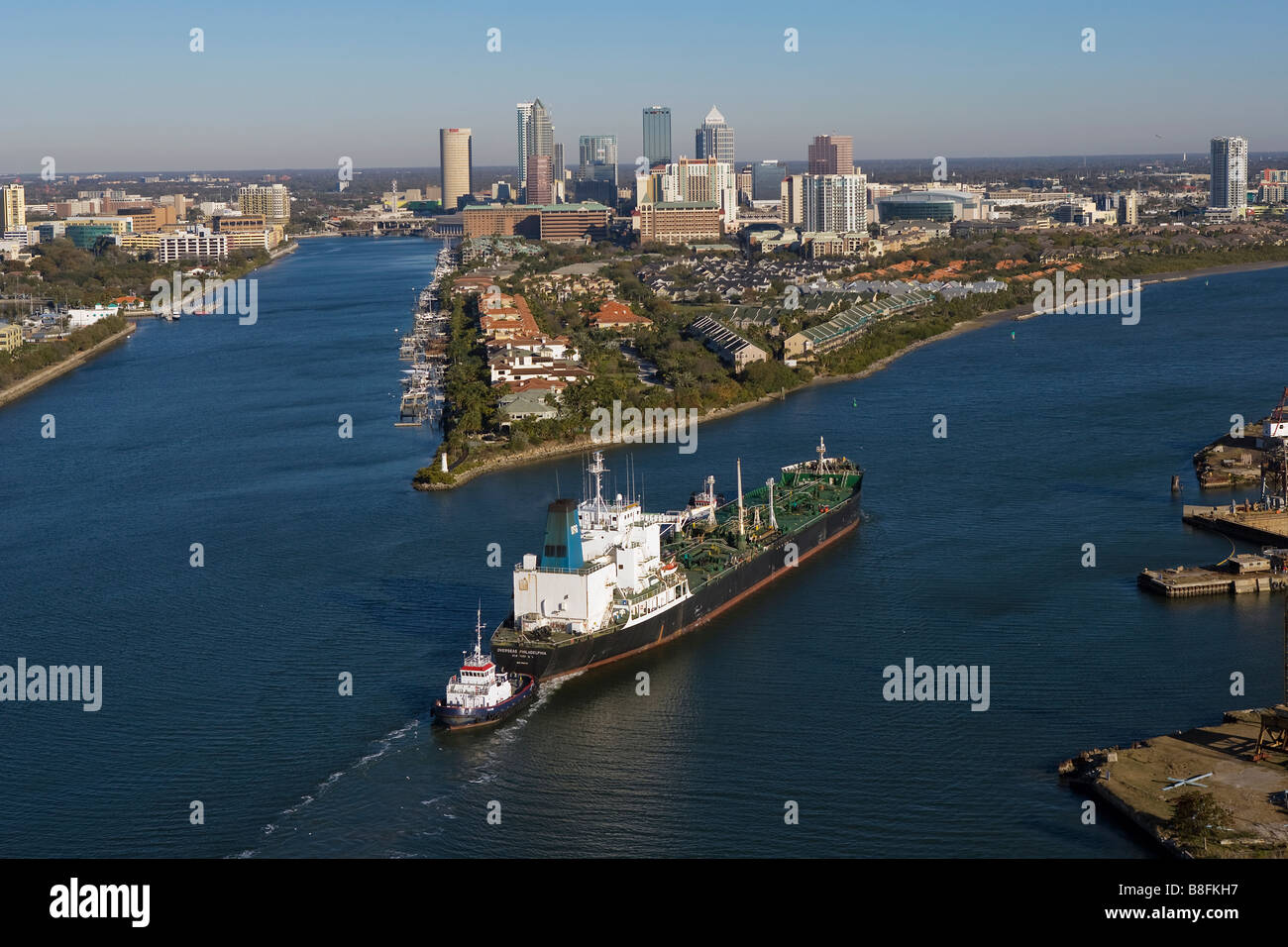 aerial view above tug boat with oil tanker Overseas Philadelphia approaching Port of Tampa Florida - Stock Image