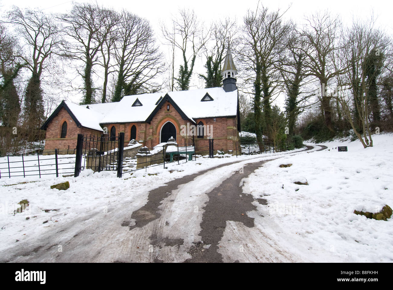 The church of St. Chad, with snow, Church of England church, Mansfield Woodhouse, Nottinghamshire, England - Stock Image