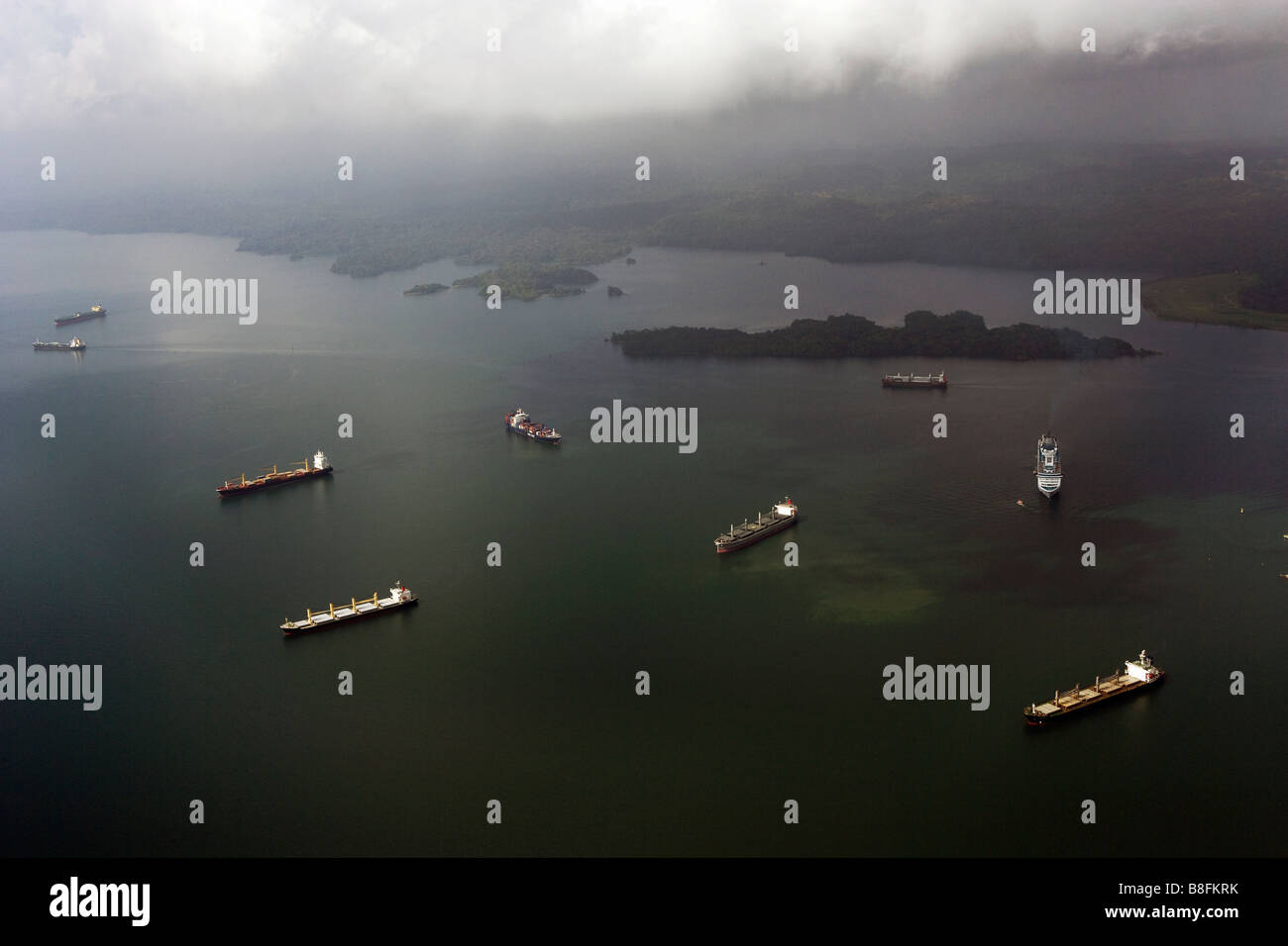 aerial view above ships waiting for transit Gatun Lake Panama Canal - Stock Image