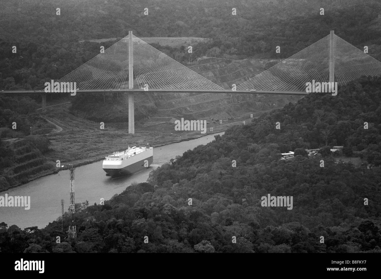 aerial above oil tanker traversing the Gaillard Cut at Centennial Bridge where Pan-American highway crosses Panama - Stock Image