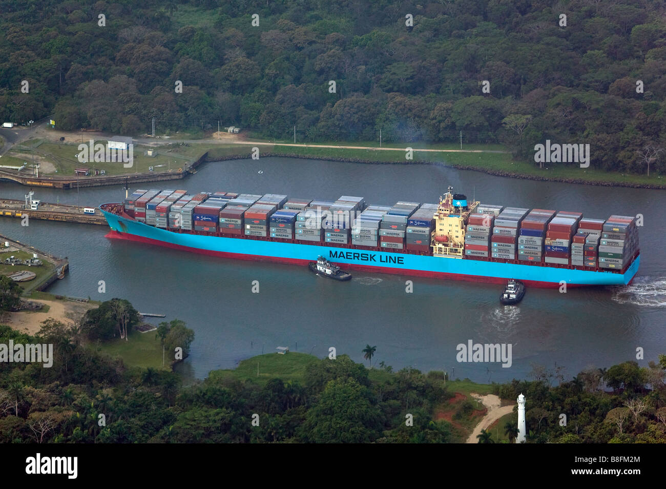 aerial above Maersk container ship entering Pedro Miguel locks Panama Canal - Stock Image