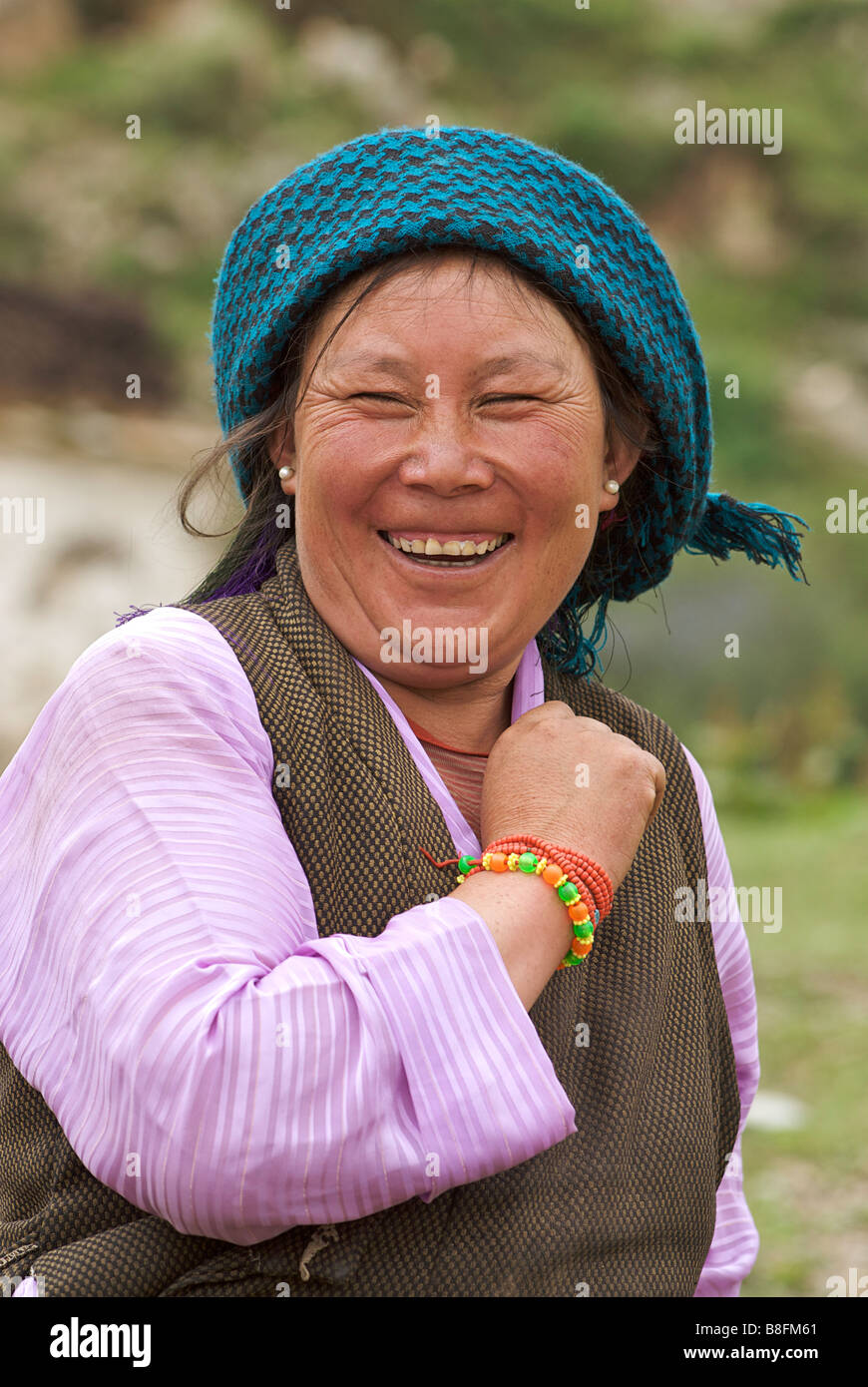Tibetan woman laughing. Tibet - Stock Image