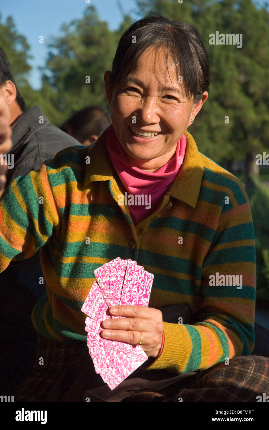 Woman Playing cards Beijing China - Stock Image
