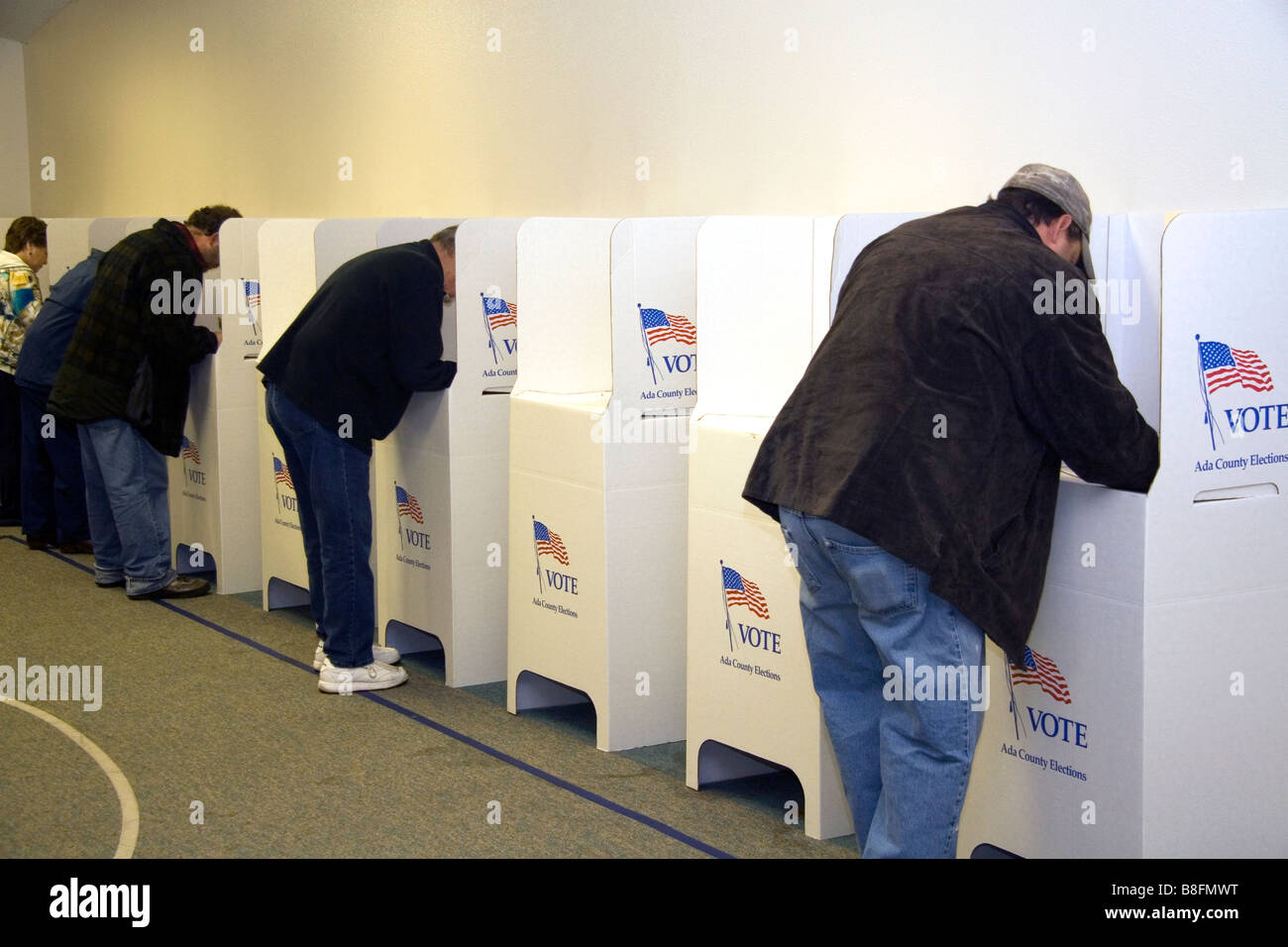 Voting in cardboard voting booths at a polling station in Boise Idaho USA - Stock Image